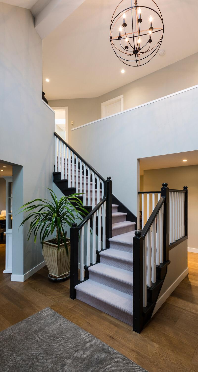 custom home full renovation stairway living area