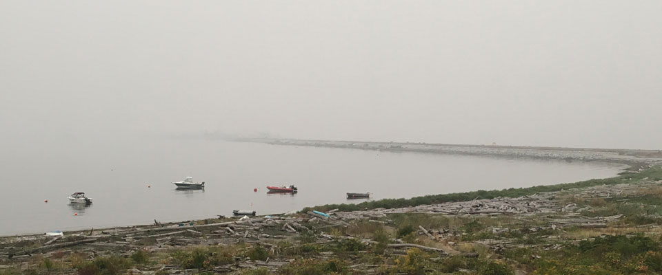 view of ocean and shoreline masked by heavy smoke from wildfires