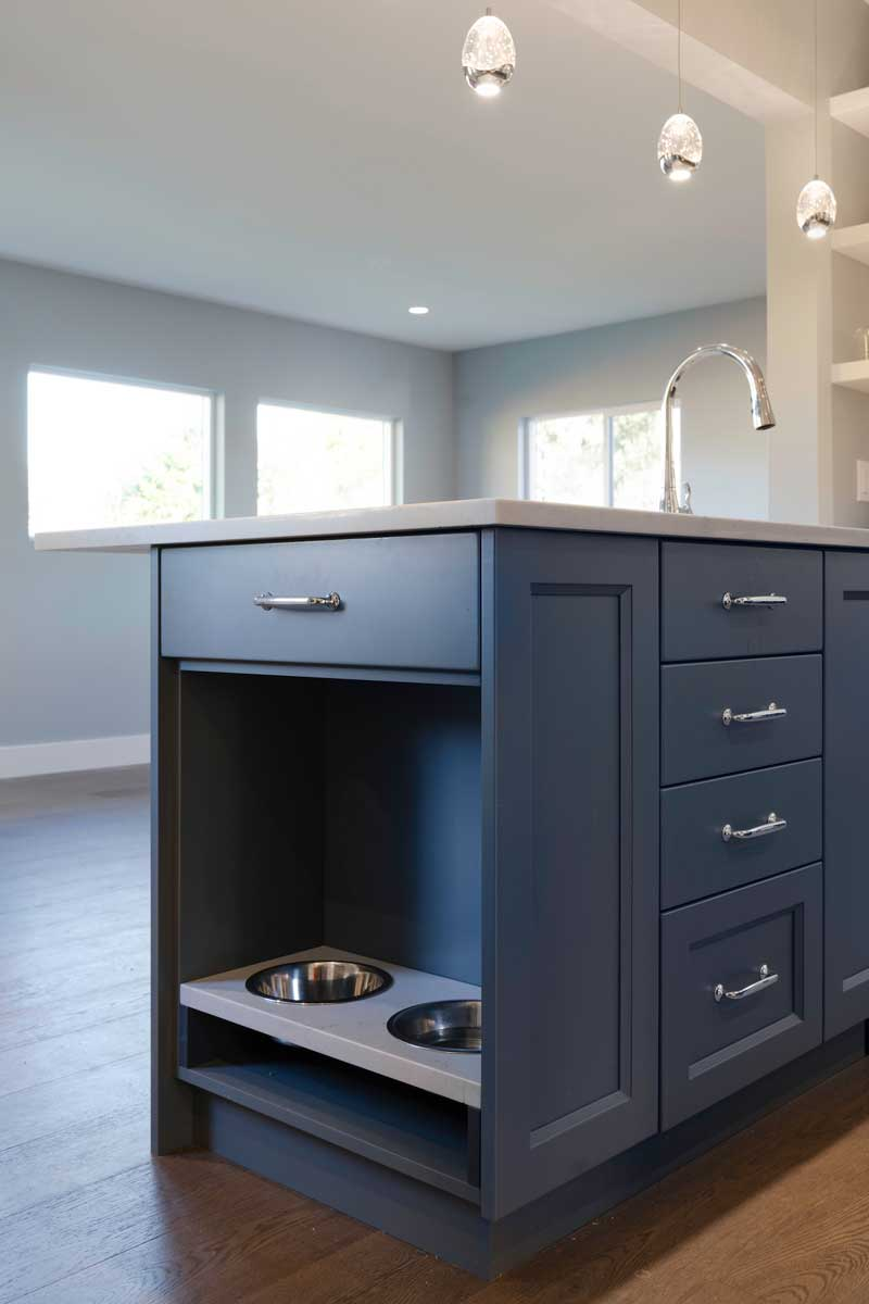 renovated kitchen cabinet with dog bowls inset