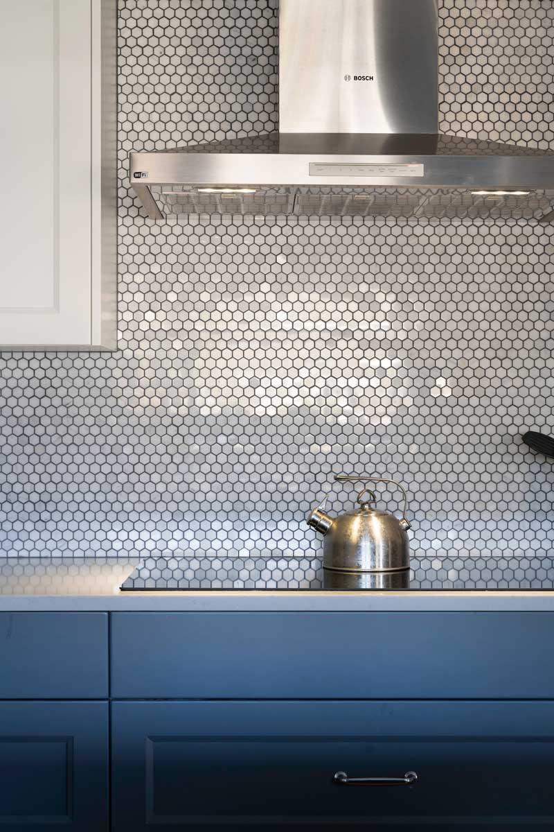renovated kitchen stovetop kettle tile shimmering backsplash